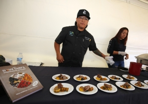 Chef Brian Yazzie serving up some braised bison.