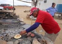 Ron checking on tortillas.