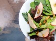 Salad with maple vinegar and chokecherry jam vinaigrette.
