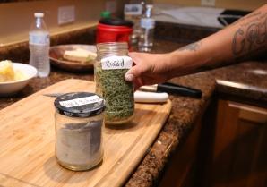 Josh shows off some Navajo ingredients (Andi Murphy photo).