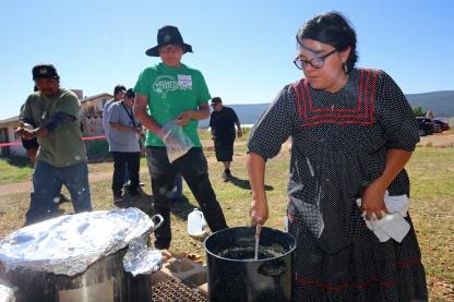 Dezeray Garcia makes Apache corn mush.