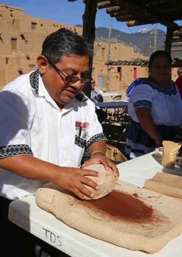 Julio Saqui grinding cocao.