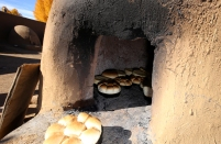 Bread baking in an orno.