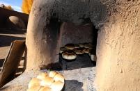 Bread baking in an orno.