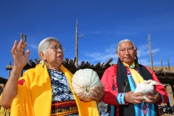 Elder Henrietta Gomez and Taos Govenor Gilbert Suazo Sr. give thanks after being gifted a Taos Pueblo Squash.