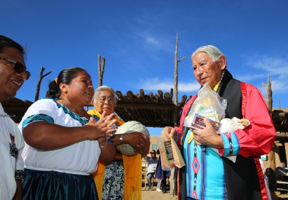 Julio Saqui and his wife, Heliadora Saqui gift Taos Govenor Gilbert Suazo Sr. with chocolate products from Belize.