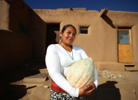 Sheryl Romero of Red Willow Farm holds the squash.