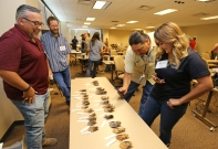 Dr. Ernie Valdez shows bat specimens to Taylor Silva and Timothy Smith at the Southwest Native American Workshop on Bats.